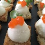 Goats Cheese with red pepper jelly served on a baked croute canape - Hart's Food & Events Canapes