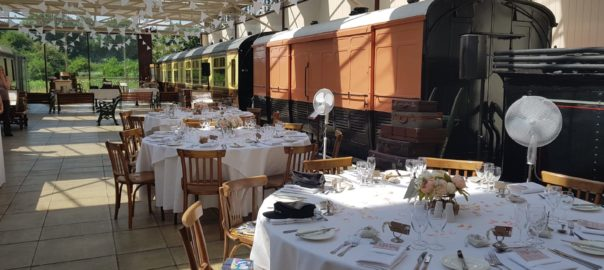 Restored Station at Buckinghamshire Railway Centre, Platform with Trains and Reception Tables - Hart's Food & Events - Wedding Venue, Food, Drink, Wedding Reception